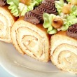 Swiss rolls with cream - Stock Photo
