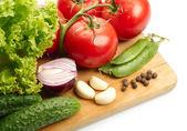 Fresh vegetables on wooden hardboard — Stock Photo