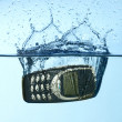 Stock Photo: Cellular splashing into water
