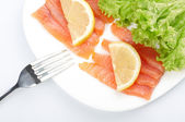 Salted salmon on white plate — Stock Photo