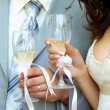 Bride and groom with champagne — Stock Photo #3709267