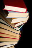 Pile of books on a black background — Stock Photo