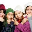 Four young girls in winter outfit — Stock Photo