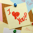 Love note pinned on cork board — Stock Photo