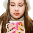 Beautiful girl drinking hot beverage — Stock Photo #2799014