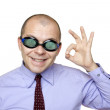 Crazy businessman with swimming goggles — Stock Photo