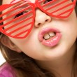 Royalty-Free Stock Photo: Young girl with funny sunglasses