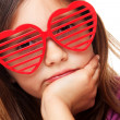 Girl with heart shaped sunglasses — Stock Photo