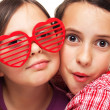 Stock Photo: Girls with heart shaped sunglasses