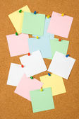 Cork board with blank notes — Stock Photo
