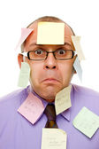 Businessman with sticky notes — Stock Photo