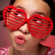 Stock Photo: Young girl with shutter shades