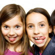 Four young girls making funny faces — Stock Photo