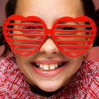 Smiling girl with shutter shades — Stockfoto