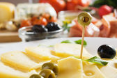 Cheese and olives — Stock Photo