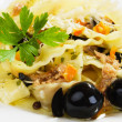 Italian pasta with tuna and black olives — Stock Photo