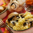 Tortiglioni pasta with champignon mushroom - Stock Photo