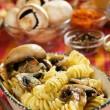 Tortiglioni pasta with mushrooms - Stock Photo