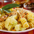 Tortiglioni pasta with cauliflower and chicken - Stock Photo