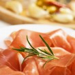 Prosciutto, italian cured ham — Stock Photo