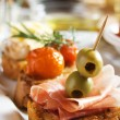 Bruschettwith prosciutto and olives — Stock Photo #3469797