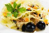 Italian pasta with tuna and black olives — Stock Photo