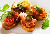 Bruschette, italian toasted bread — Stock Photo