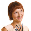 Young woman with a brushes for a make-up — Stock Photo #2695148