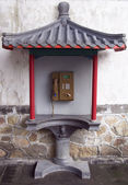 Public telephone box in chinese style. — Stock Photo
