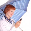 Girl with a mobile phone and an umbrella — Stock Photo #3331072