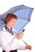 Girl with a mobile phone and an umbrella — Stockfoto