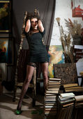 Woman and books — Stock fotografie