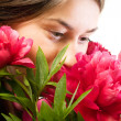 Smelling flower — Stockfoto