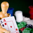 Manikin plays poker - Stock Photo