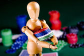 Manikin plays poker — Stock fotografie