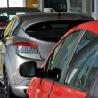 New cars in showroom — Stock Photo