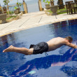 Man tries to jump in water in pool — Stock Photo