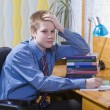 Pupil schoolboy reflected with pile — Stock Photo #2986765