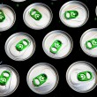 Aluminum cans in drops of water with key — Stock Photo