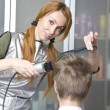 Pretty woman hairdresser cuts client — Stock Photo #3083900