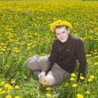 Teenager on meadow with dandelions — Stock Photo #3083966