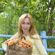 Stock Photo: Young woman-mushroom picker