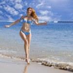 Woman, running along ocean coast — Stock Photo #3084049