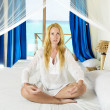Young pretty woman in bed with ocean — Stock Photo #3084085