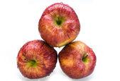 Three juicy apples in drops — Stock Photo