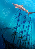 Sinking ship on sea bottom and sharks — Stock Photo