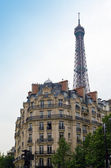 Old house and kind on Eiffel tower. Paris. — Stock Photo