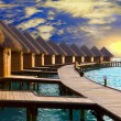 Royalty-Free Stock Photo: Maldives. Villa on piles on water at the time sunset.
