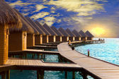 Maldives. Villa on piles on water at the time sunset. — Stock Photo
