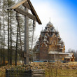 Cross before Wooden orthodox church in name of Cover All-holy mother of God — Foto de Stock